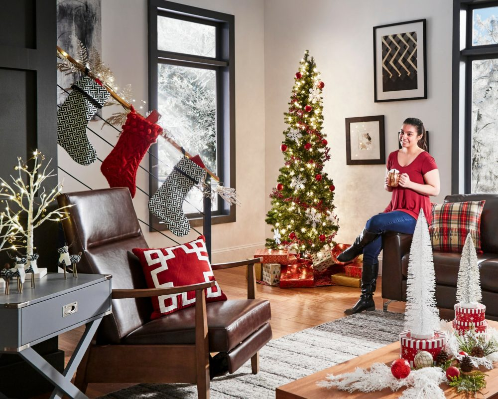 woman sitting on couch in modern christmas loft