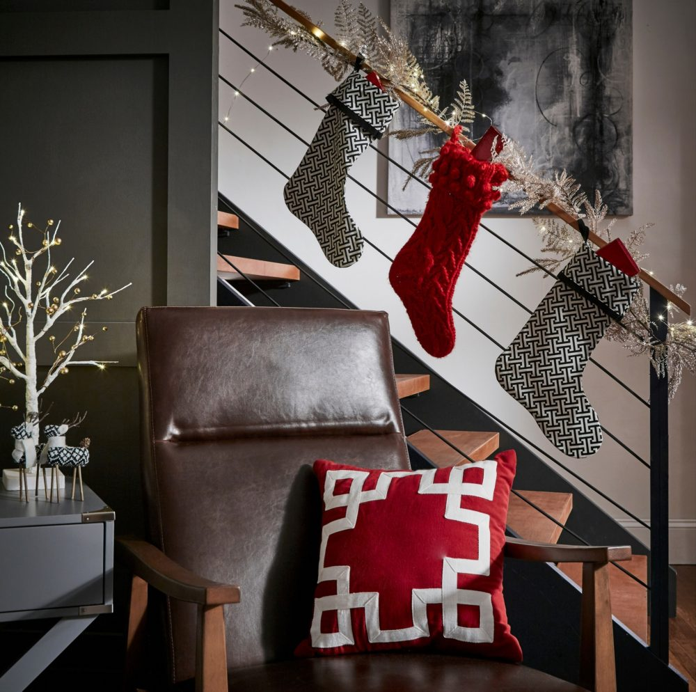 stockings on railing with modern chair and accent pillow