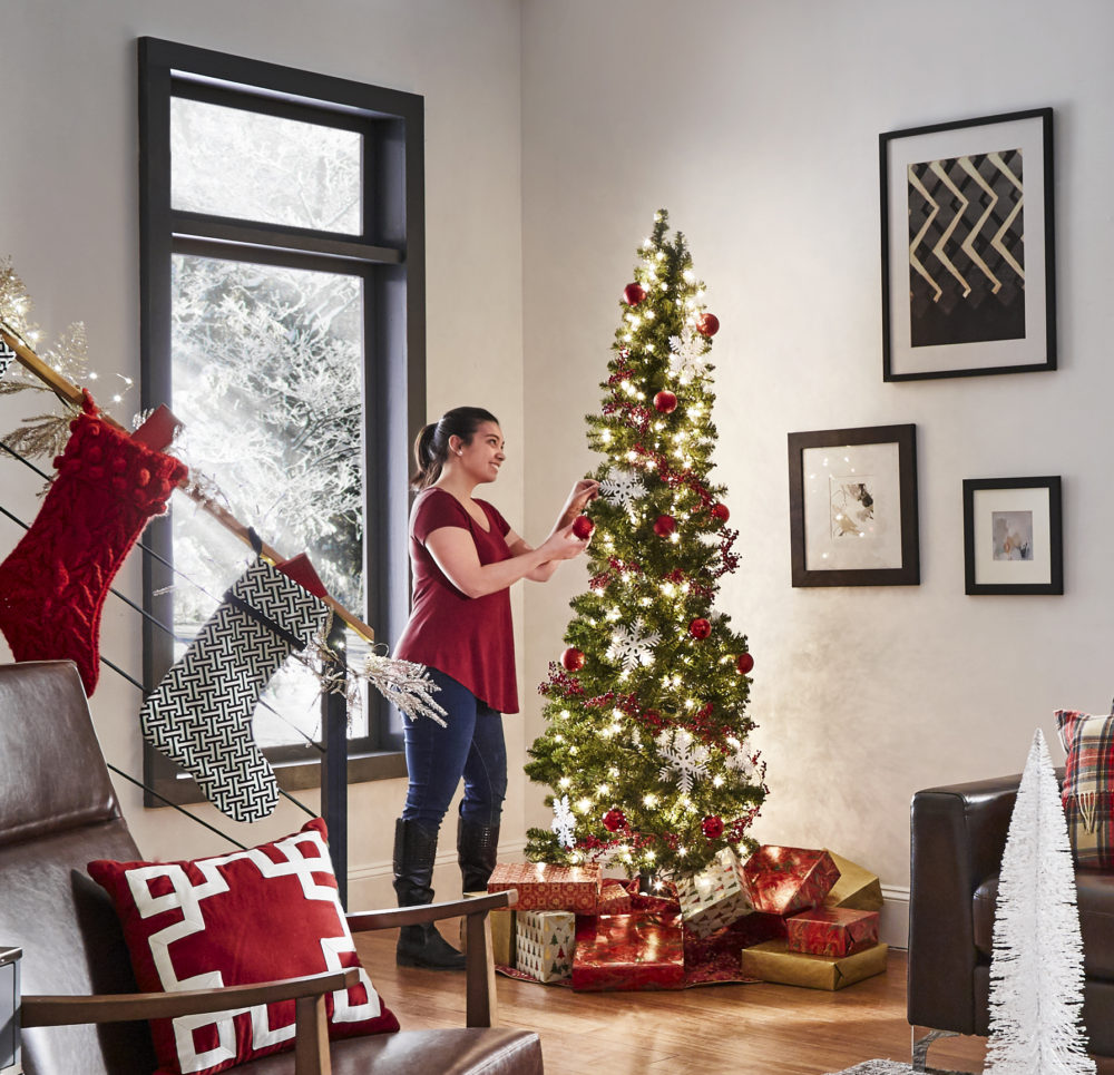 woman decorating christmas tree iNSPIRE Q modern christmas loft