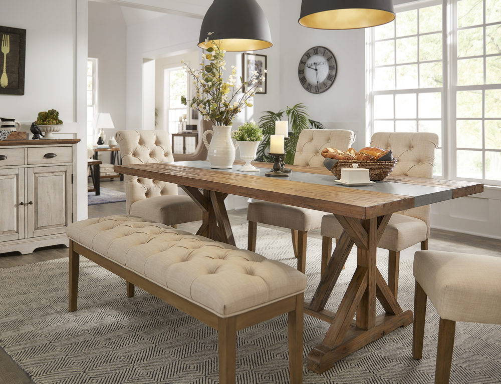 A wider shot of the farmhouse look. In addition to the decorated Rustic Pine Concrete Inlaid Table Top Dining Table, we have four beige linen button tufted parsons chairs and one matching beige linen button tufted dining bench. In the background is an antique white finished server.