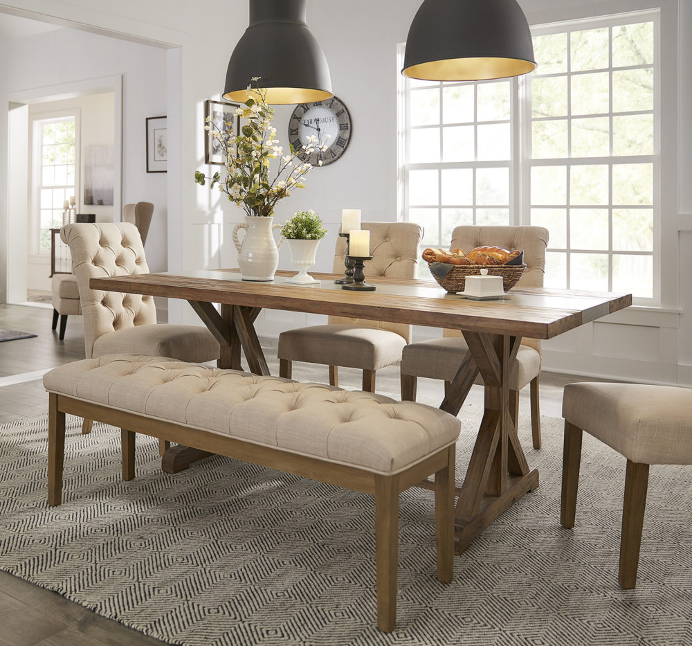 Another angle of the farmhouse look. Like the previous image, this one shows the full dining set. We have the Rustic Pine Concrete Inlaid Table Top Dining Table surrounded by beige linen button tufted parsons chair and bench.