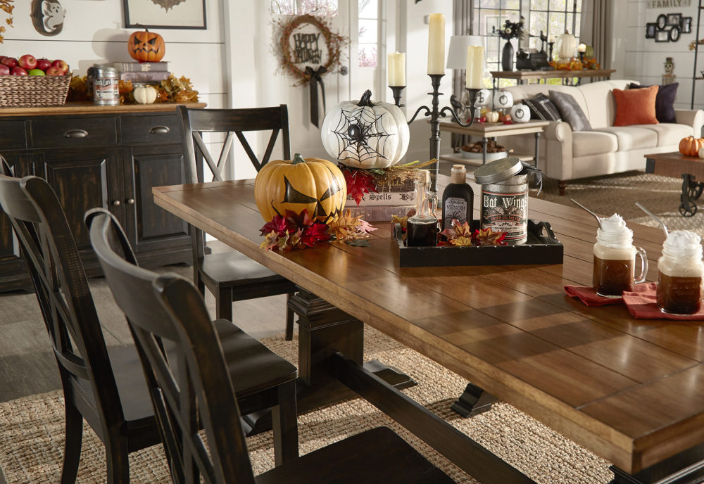 iNSPIRE Q Farmhouse Holiday Decor-- Dining room table with spooky pumpkins, apple cider, and 'bat wings'