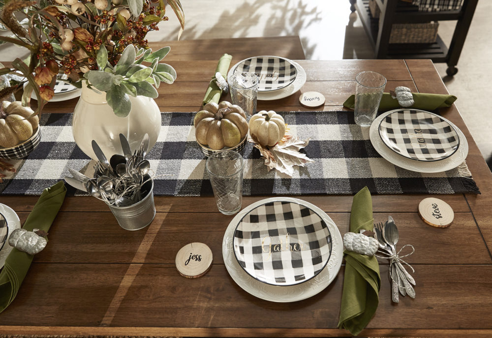 iNSPIRE Q Farmhouse Holiday Decor-- closeup of thanksgiving table decor (featuring buffalo check, pumpkins, and green foliage!)