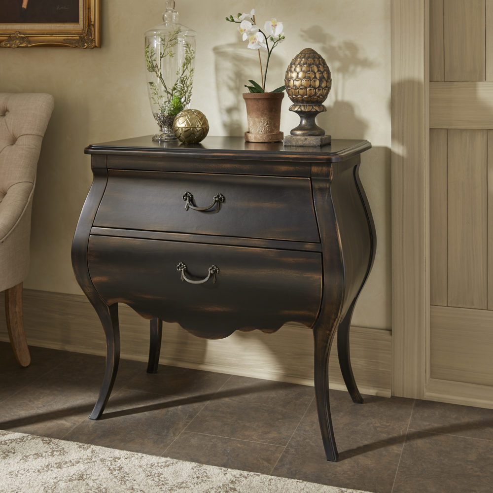 A close-up shot of the antique black 2-drawer nightstand. The distressed finish creates a vintage look for the piece, perfect for any bohemian interior design.