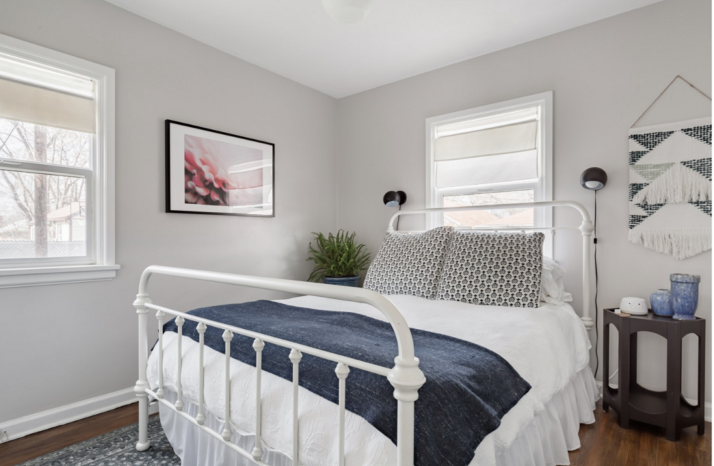 iNSPIRE Q white metal bed in bedroom of Salt Lake City Airbnb.