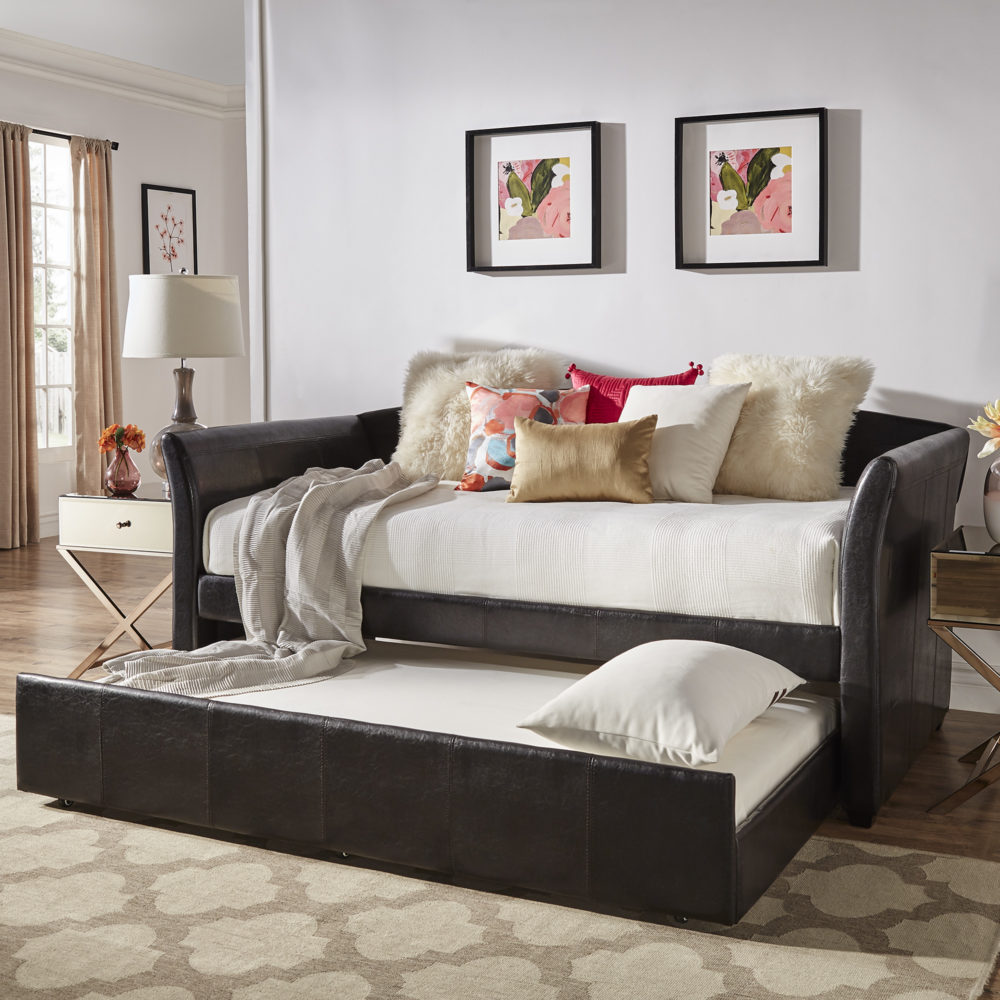 Another one of our tips and tricks for Airbnb hosts is all about multifunctionality. And there is nothing more multifunctional than the iNSPIRE Q black faux leather upholstered day bed with pulled out trundle.