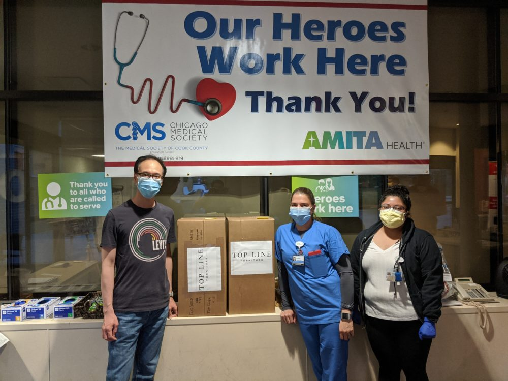 Inspire Q team members drop off boxes of face shields at AMITA Health.