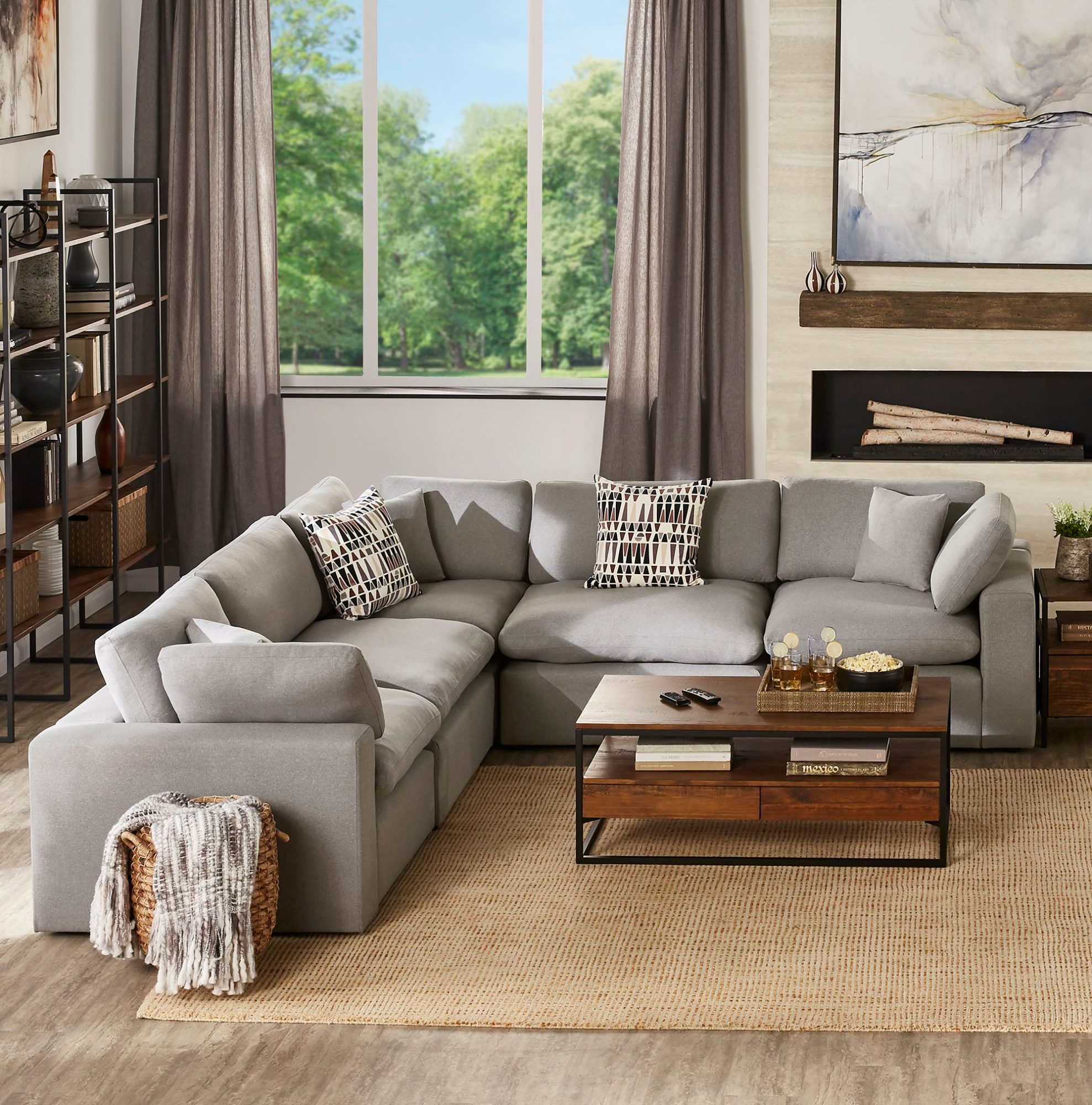 Invest in a cozy sectional sofa. This sofa features 5+ seats, grey linen weave upholstery, and plush cushions made with a down blend. Sectional sofas are great to center around coffee tables or ottomans.