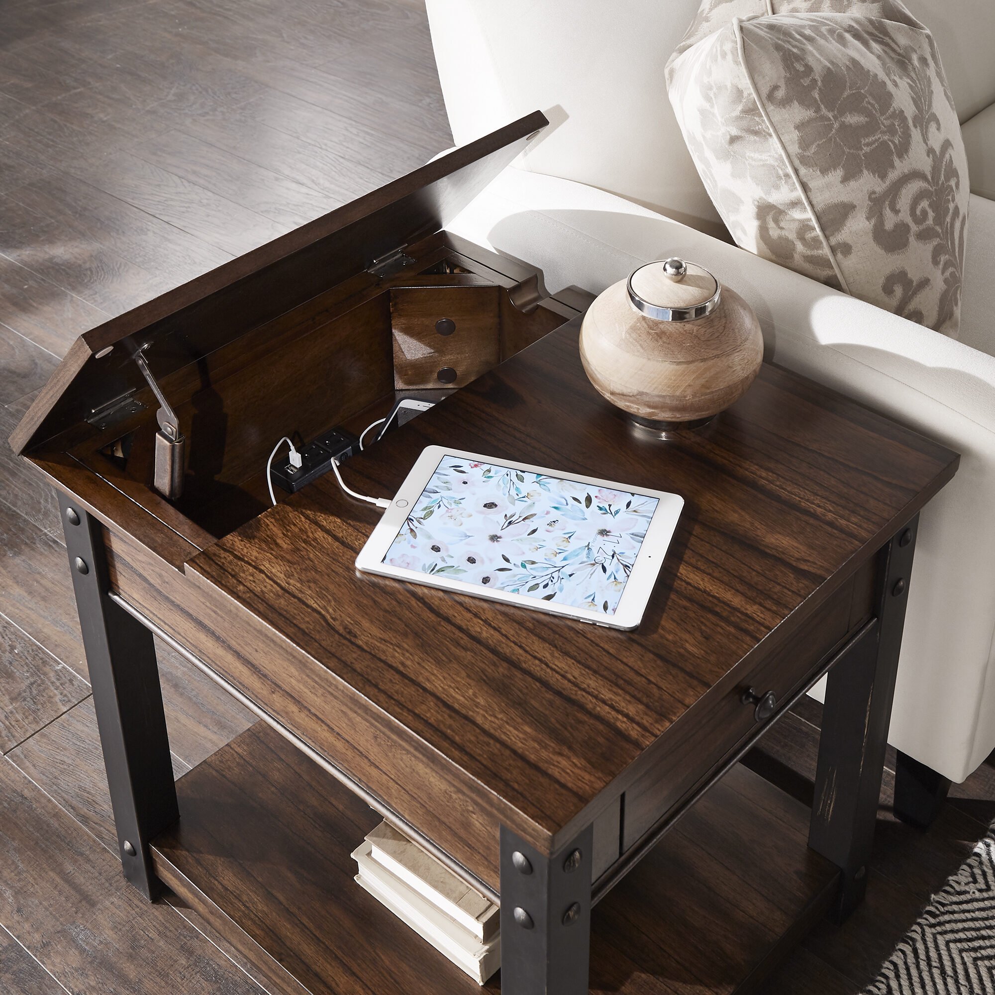 Nightstands make great small space furniture. This one pictured, the Richter Dark Cherry Finish End Table by iNSPIRE Q Classic, comes with a single drawer, a lower open shelf, and a charging station in a compartment under the table top.