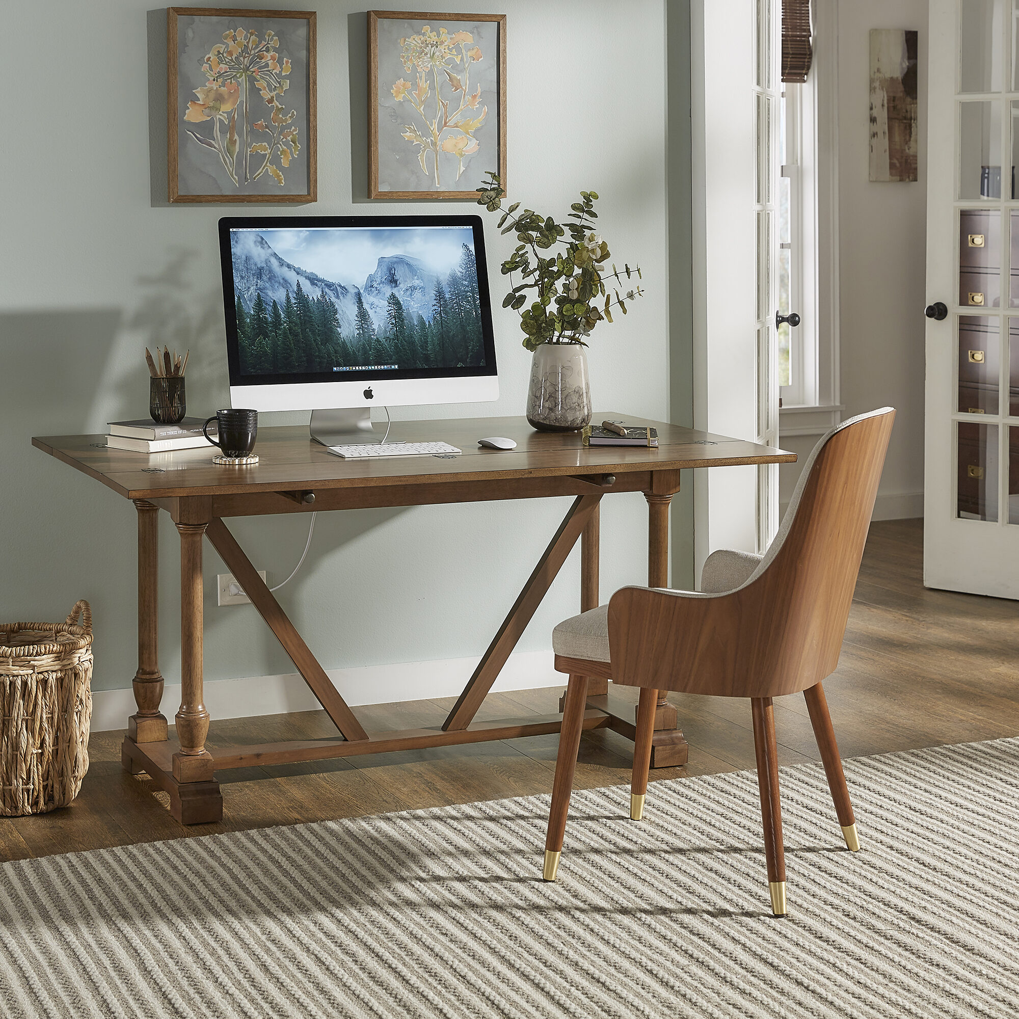 Desks take up a lot of valuable floor space, but convertible tables work well for small spaces. Our Edmaire Convertible Dining Table and Office Desk by iNSPIRE Q Classic has a drop leaf design so you can fold it up and push it against the wall with enough room to work as a desk. If you need more space or are working with friends, you can extend the top!