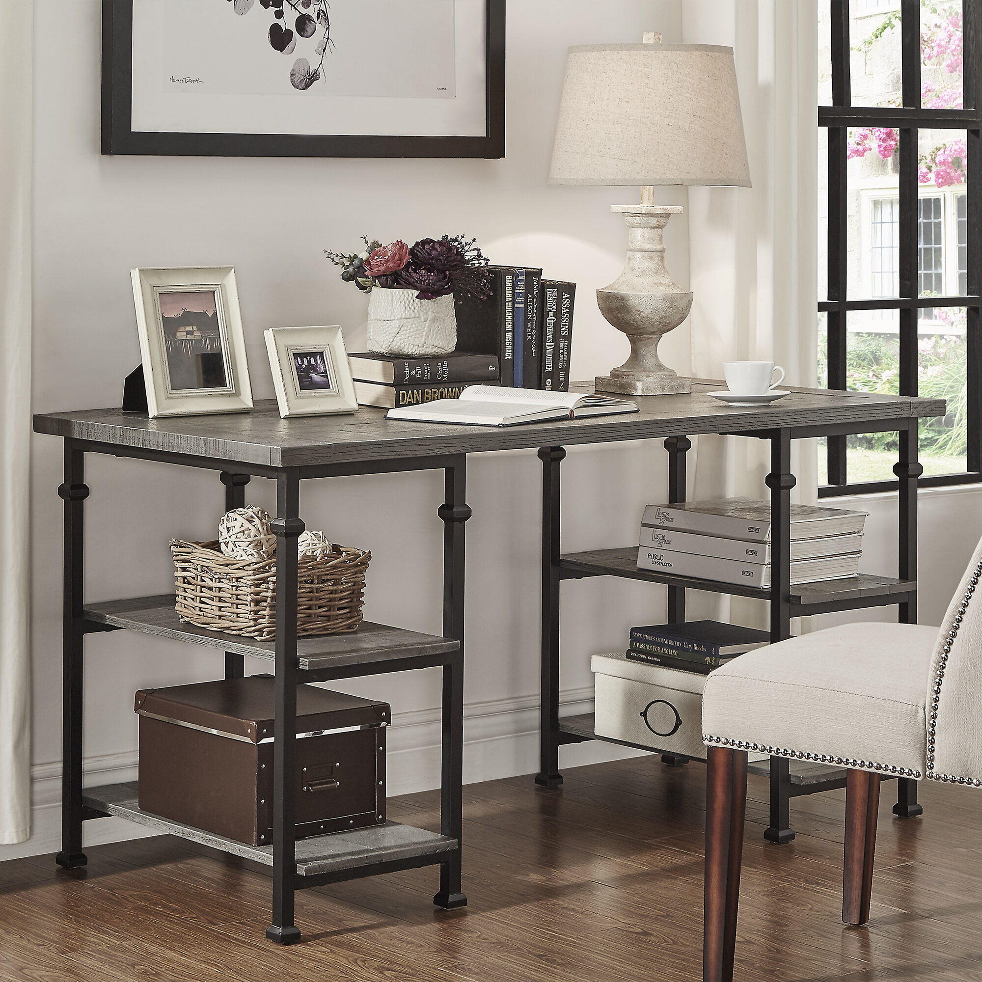 The final piece of teen bedroom furniture: a desk. This is our Myra Vintage Industrial Storage Desk by iNSPIRE Q Classic. It comes in three finishes: brown, bistre brown, and grey. The surfaces have a wood grain finish while the frame is black metal. This desk offers four airy shelves for open, easy-to-reach storage.