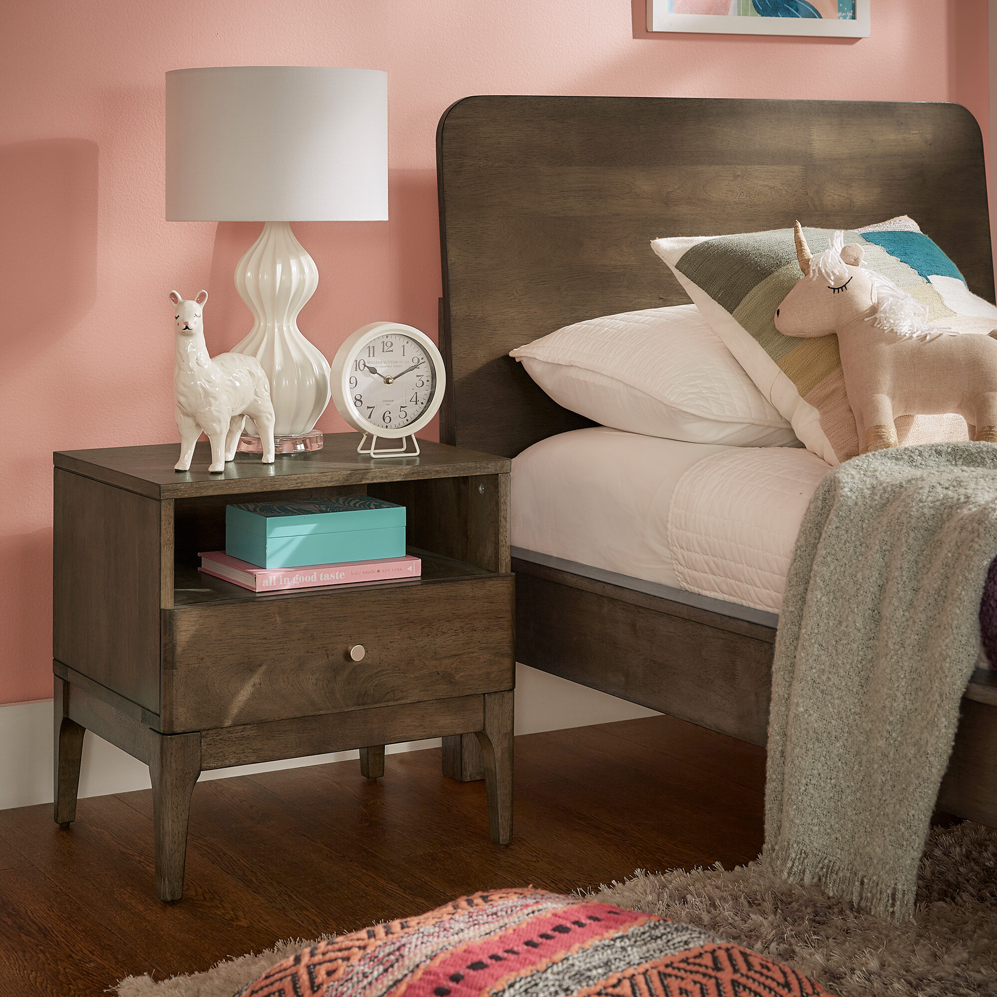 The fifth piece of teen bedroom furniture is a nightstand. This is our Ozan Walnut Finish 1-drawer Nightstand by iNSPIRE Q Modern. This nightstand has a walnut finish. It has a single drawer and a single cubby for concealed and open storage options.