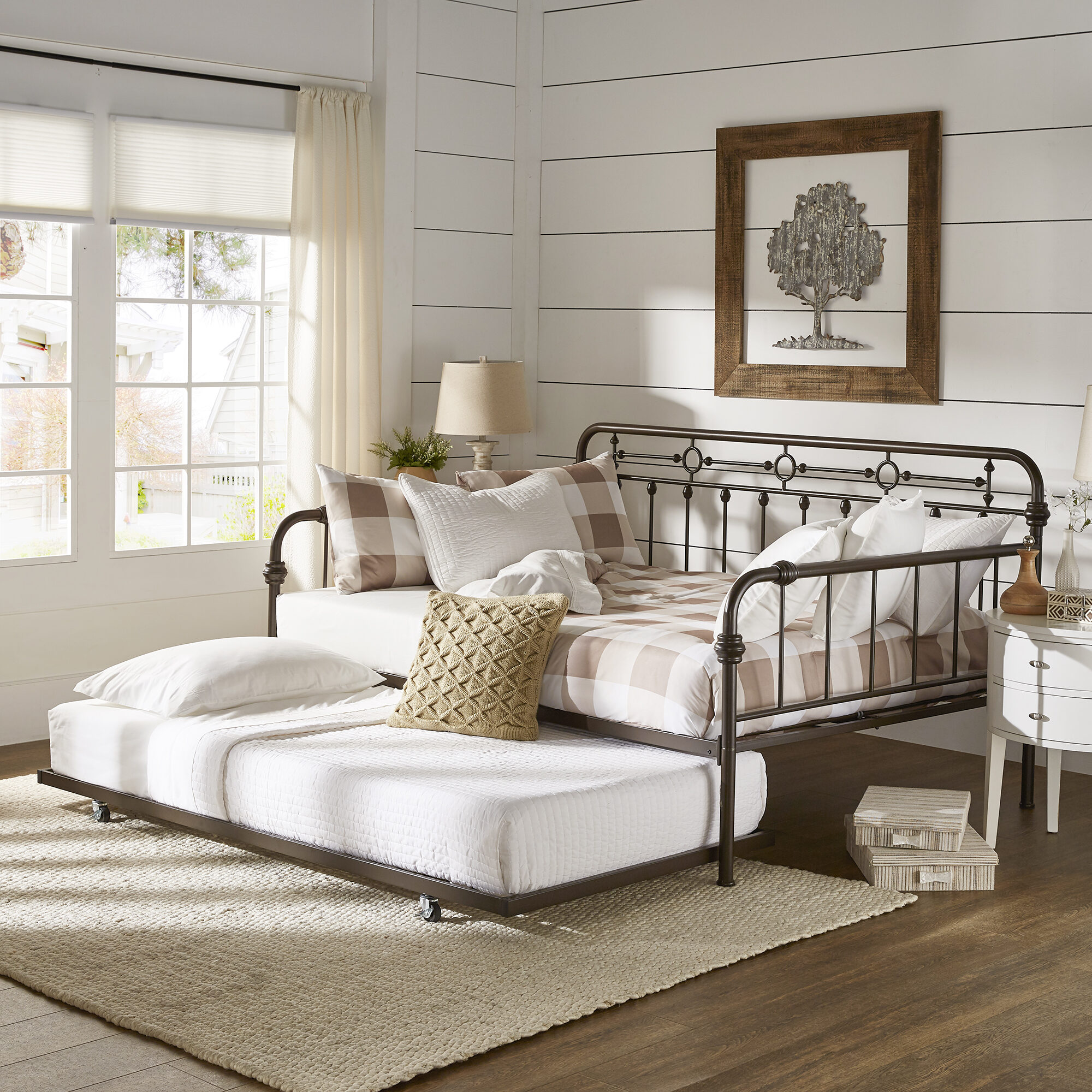 One of our kids' bedroom ideas is to use a daybed. A daybed, like this brown metal one, is versatile, as it can be used as a sofa or as a bed. This one pictured also has a trundle bed underneath, great for overnight guests.