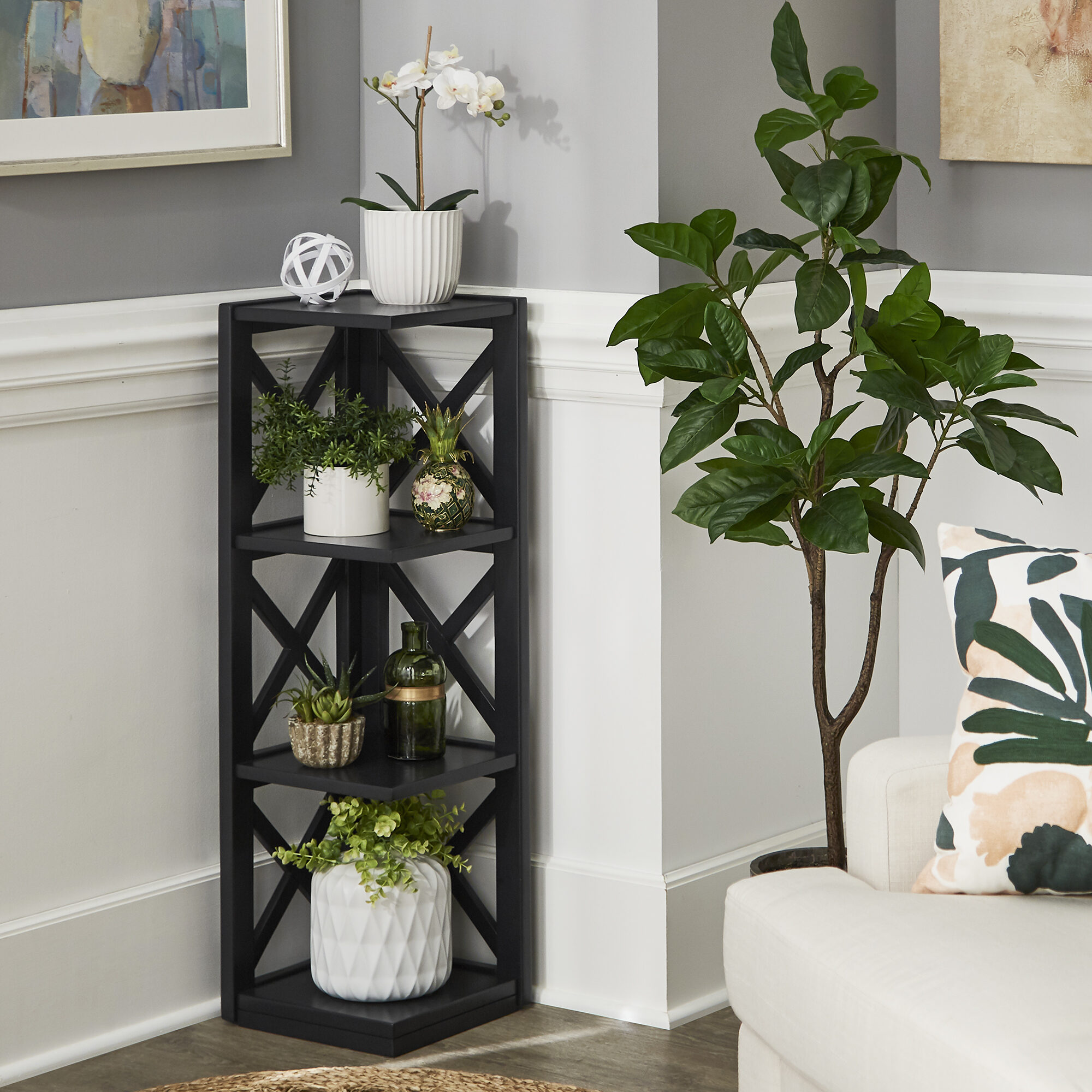 Corner bookcases are tiny but mighty pieces of small space furniture! Our Kelsey X-Frame 3-Shelf Bookcase by iNSPIRE Q Classic is perfect for filling those nooks and crannies without sacrificing floor space.