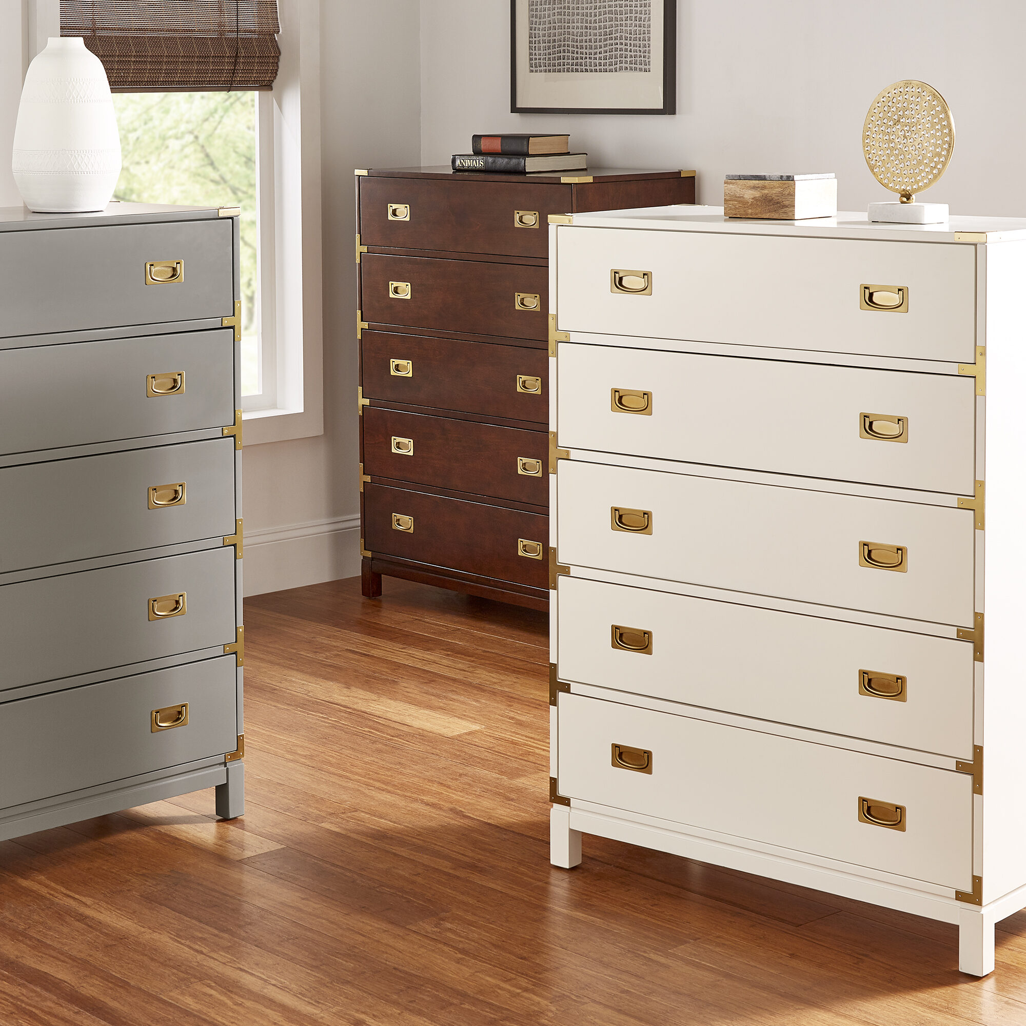 This piece goes hand in hand with the dresser: a chest of drawers. This is our Kedric 5-Drawer Gold Accent Chest by iNSPIRE Q Bold. This chest is six drawers tall, and like the dresser, comes in grey, espresso, or white. Also features gold metal accents and drawer pulls.