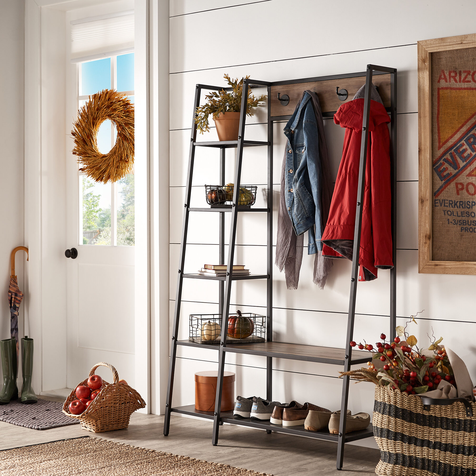 The second of our three back-to-school tips for parents involves rethinking the entryway. This is our Duke Matte Black Finish Metal Coat Rack with Ladder Shelf by iNSPIRE Q Modern. It comes with four coat hooks and five shelves.