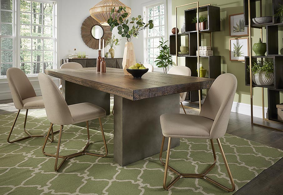 A dining room is displayed, decorated with wood furniture and green plants as decor.