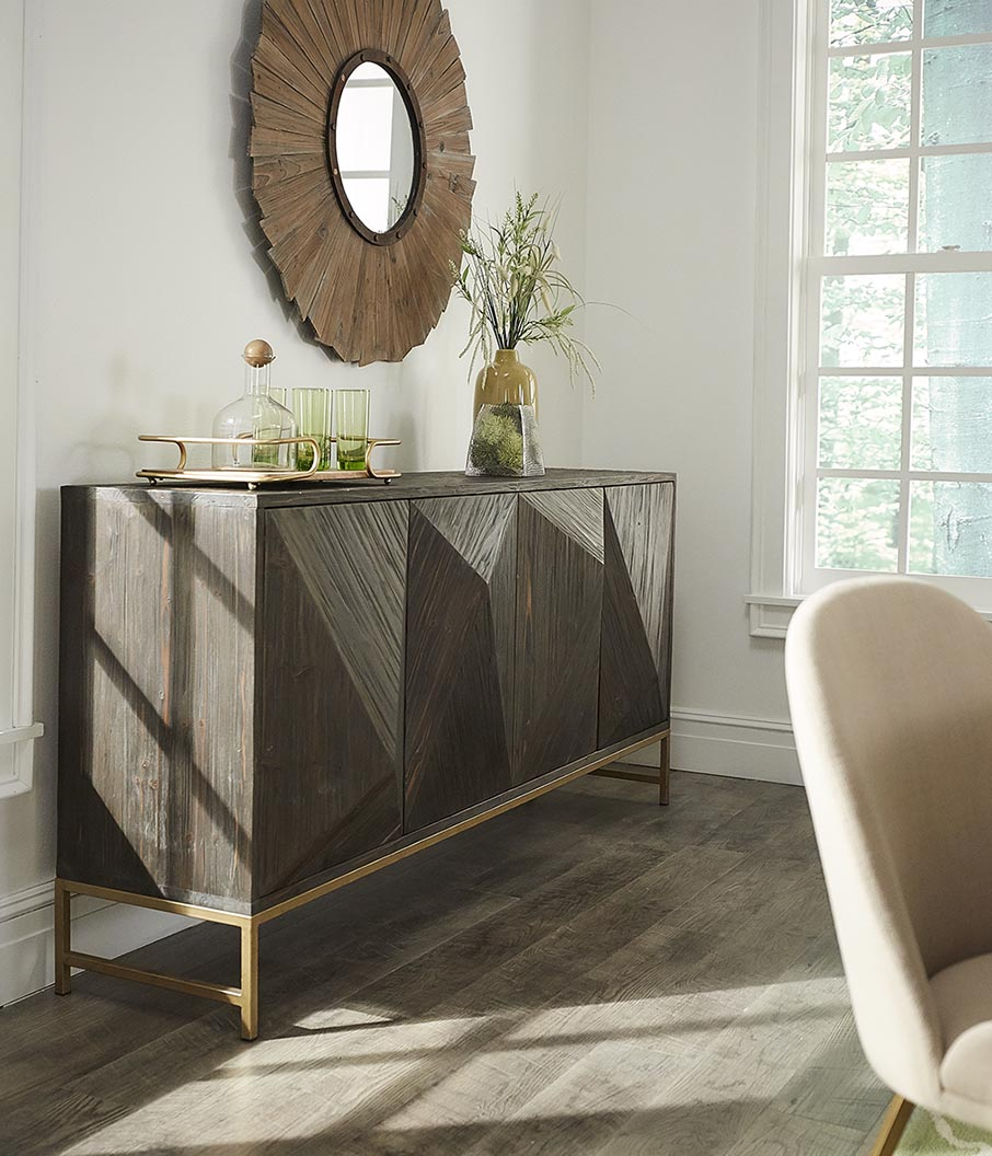 Here we have our Moffit Antique Gold Finish Angled Reclaimed Wood Buffet by iNSPIRE Q Modern decorated with green-colored decor and some plants for a lively, natural vibe for your space.