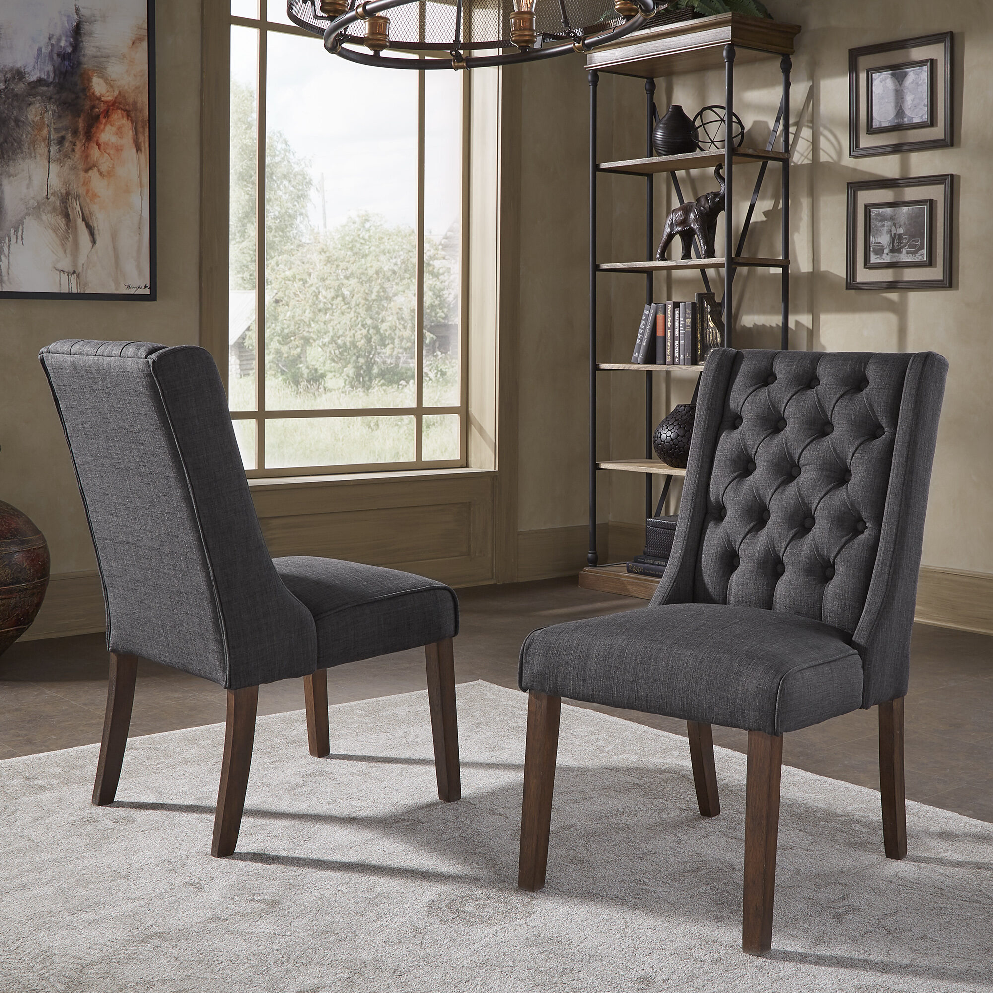 We could give you a thousand different dining room ideas and there are at least a thousand more different types of chairs. Here we have our Dark Grey Linen  Tufted Upholstered Side Chairs (Set of 2).