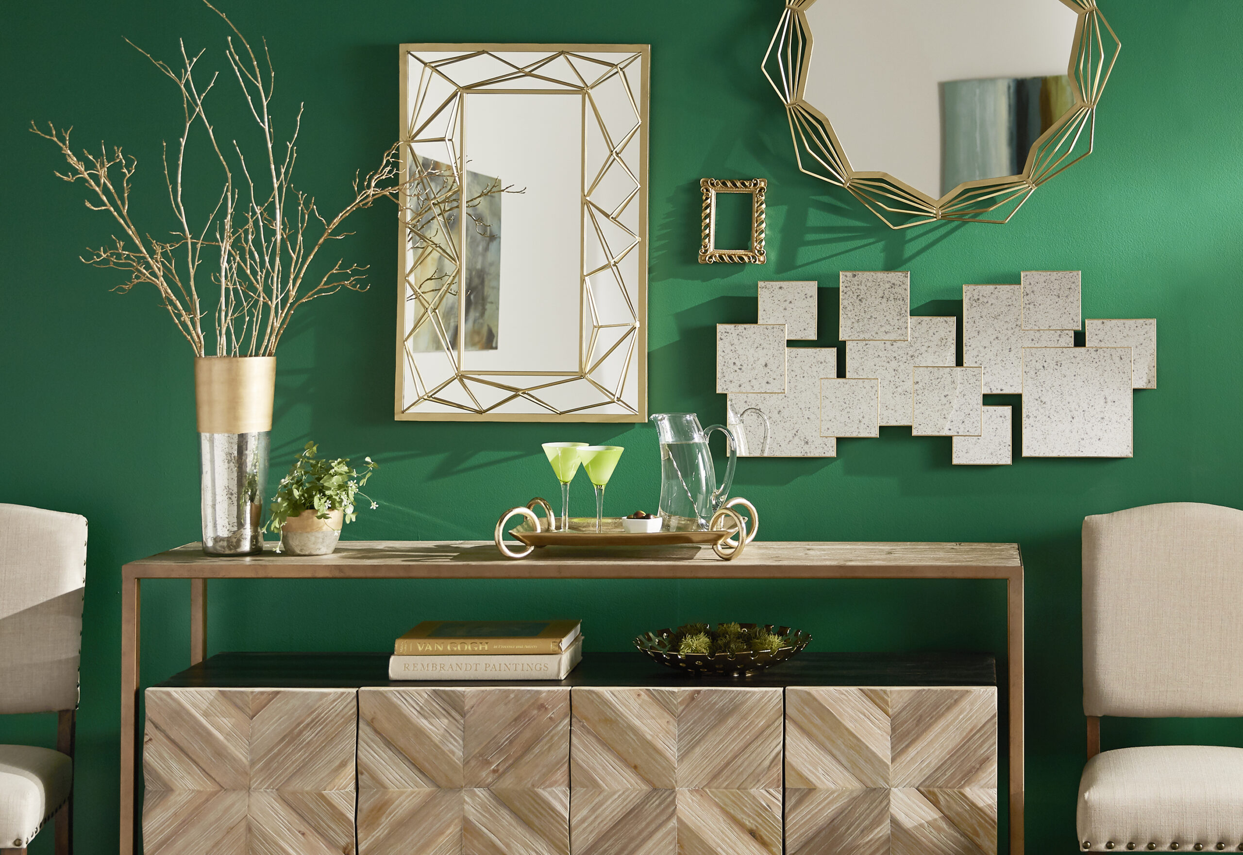 This picture shows what this post is all about: mirror decorating ideas. Three different mirrors hang over a server for an eye-catching look.