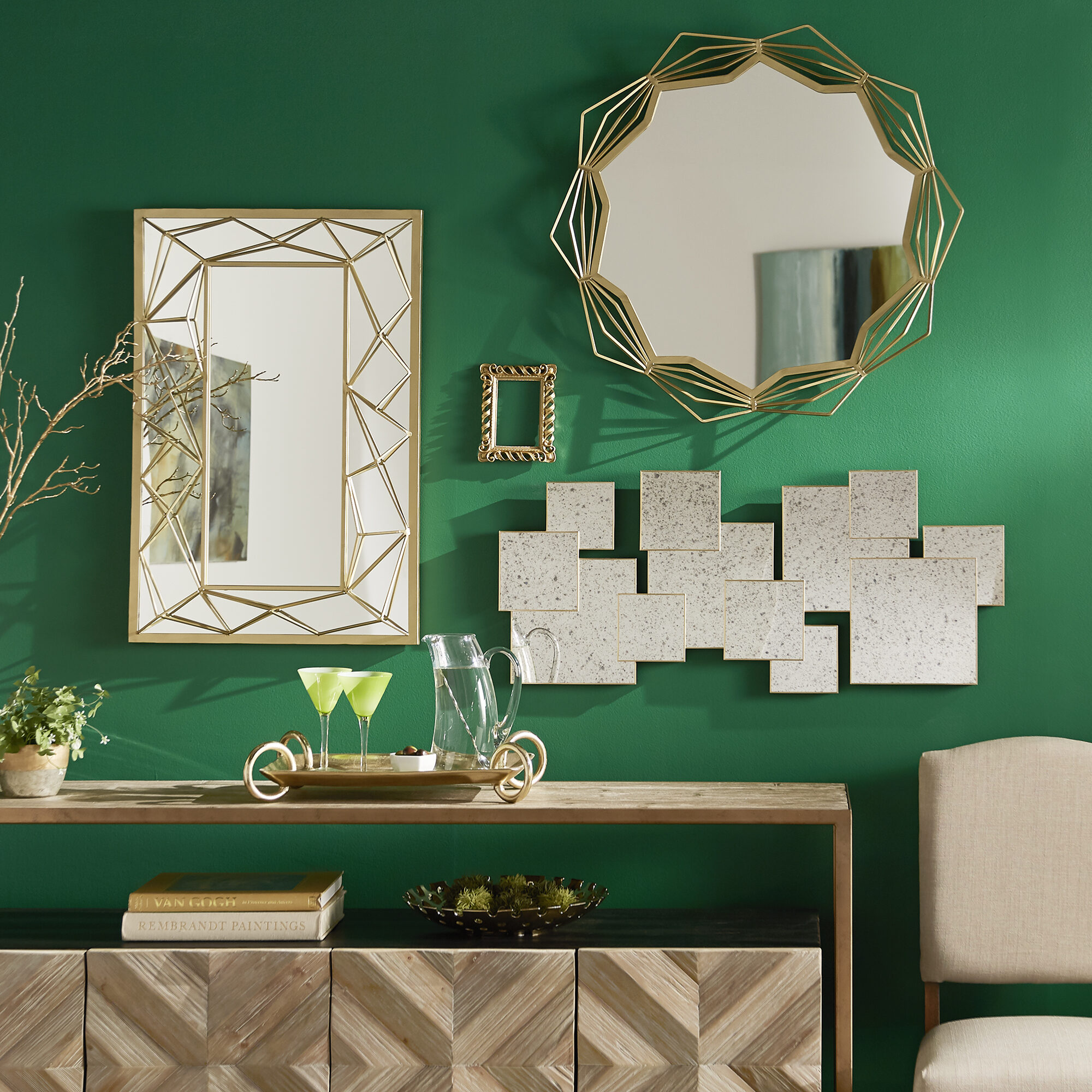 Here we have a gallery wall with a variety of mirrors. The mirrors all have different looks to them, but they share the same gold finishes for a cohesive and exciting look.