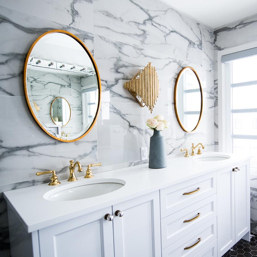 This mirror decorating idea is not unlike the previous one. A double bathroom vanity features two brass-framed mirrors hung over the sinks. The frames of these mirror match the bathroom accents for visual interest.