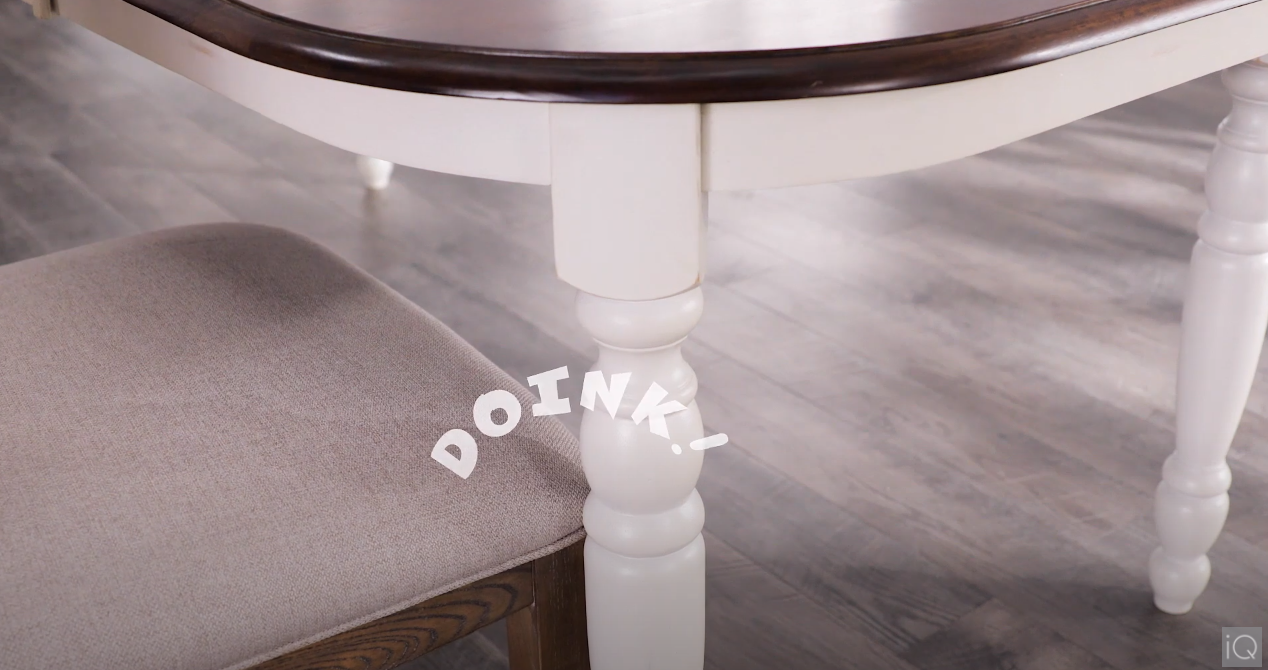 You can't start exploring dining room ideas without starting with a table! Here, we show a chair banging against the leg of a standard dining table. But with a pedestal-style base on your table, you'll never have to worry about this again!