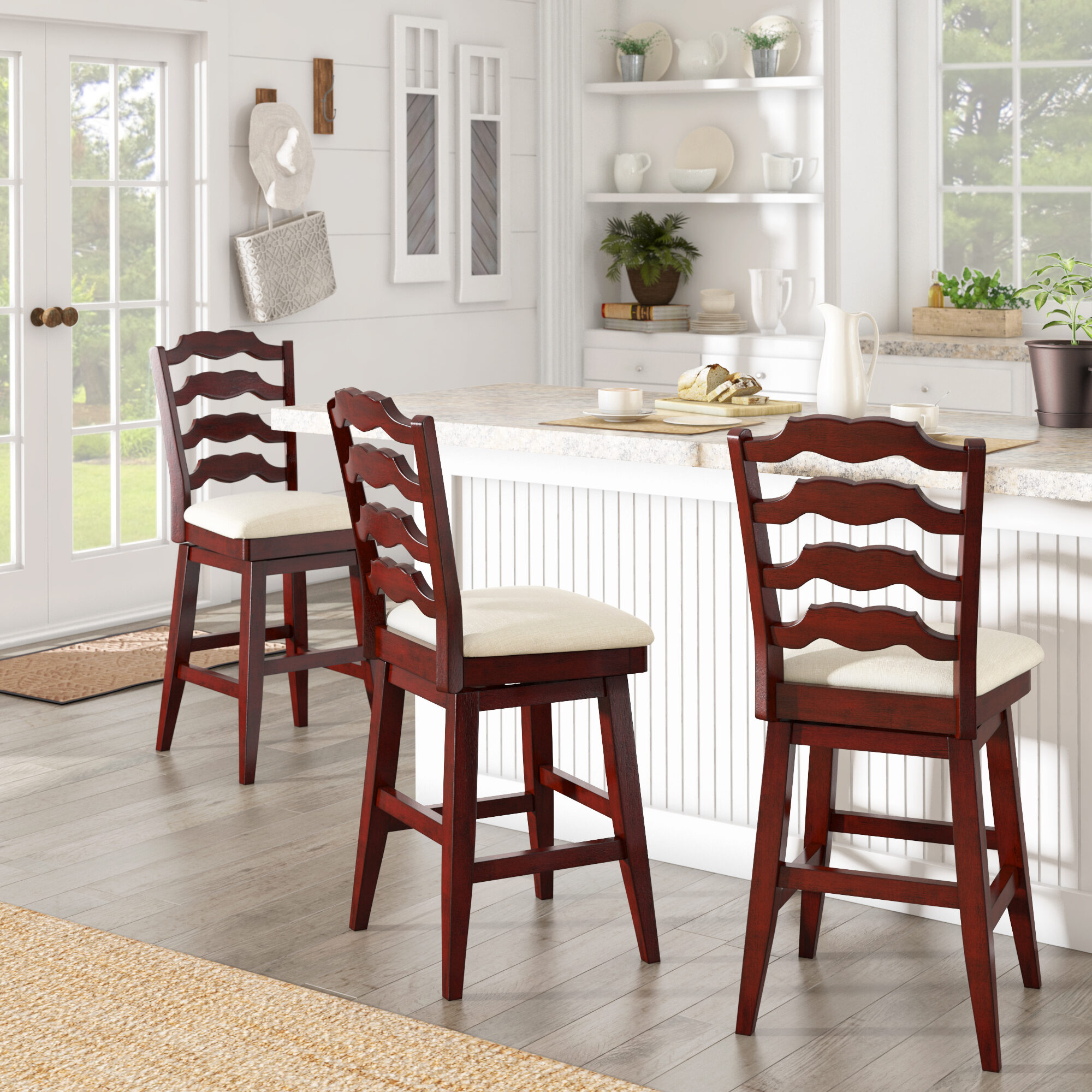 This red home décor idea features three of our French ladder back counter height swivel stools. They feature an antique berry red finish and beige linen seats. They're placed around a white countertop for an eye-catching contrast.